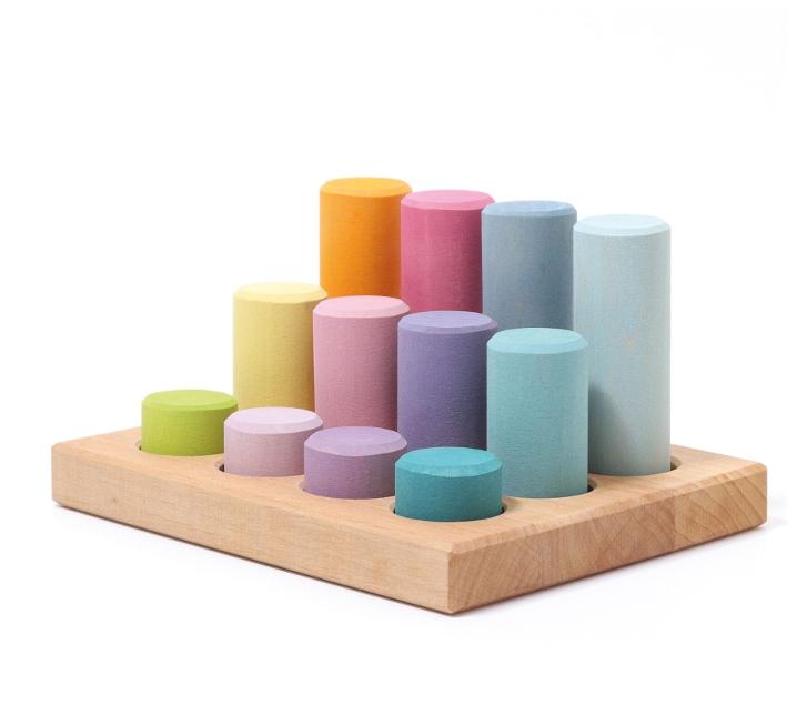 Grimm 's. Cilindres per encaixar colors pastel